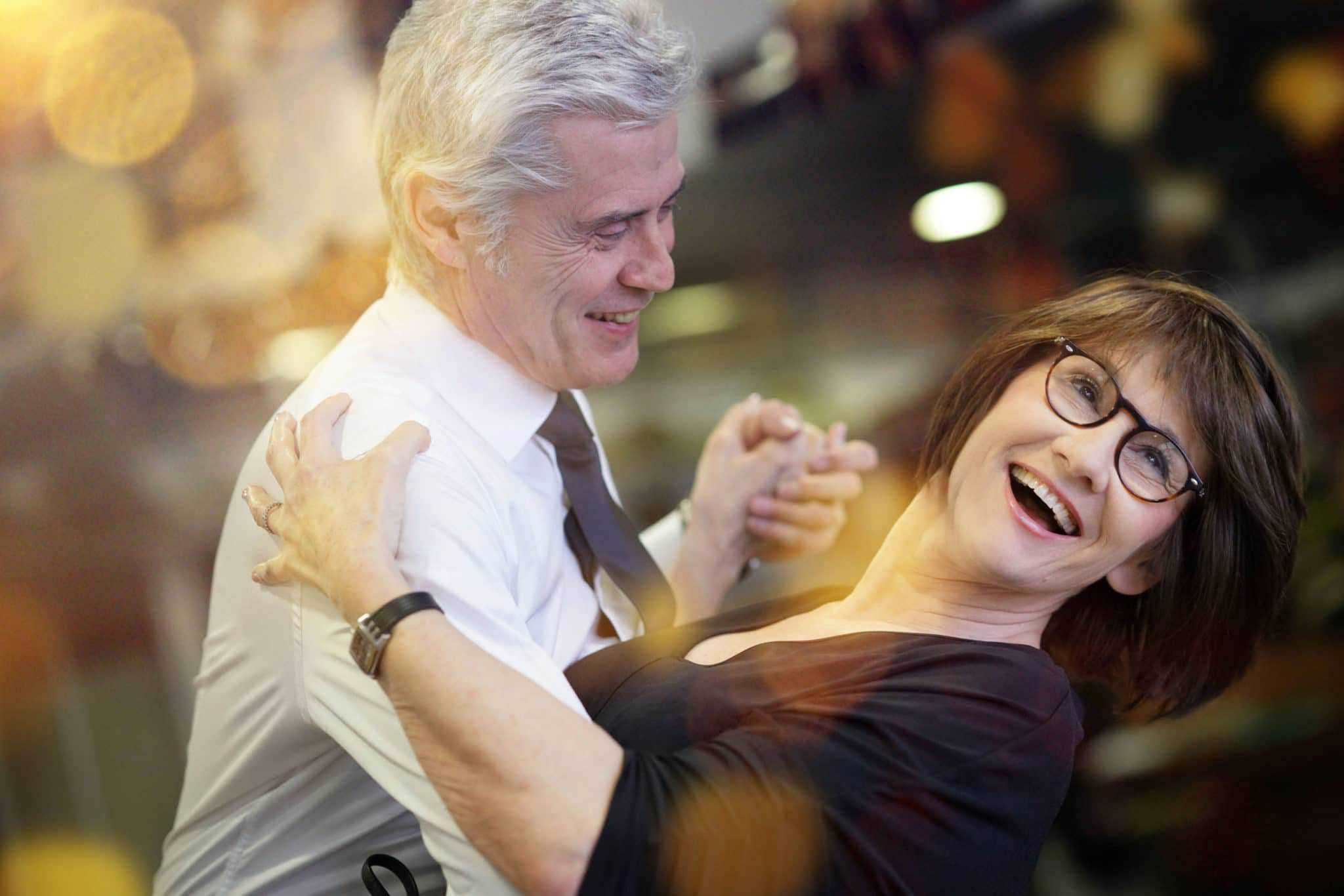Romantic senior couple dancing at a dance studio