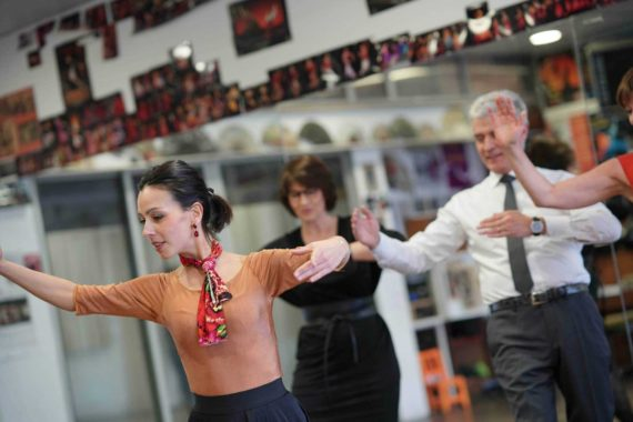 Group of adults dancing in a dance class at a dance studio