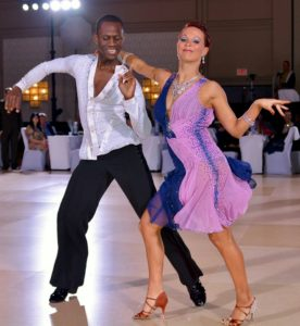 Trish and Abe dancing cha cha at a dance competition